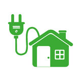 Green eco house connected to light bulb Stock Photos