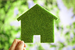 Green eco house environmental background. For future residential building plot Stock Photos