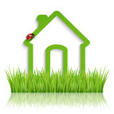 Green eco house. Green home icon on white background Royalty Free Stock Photo