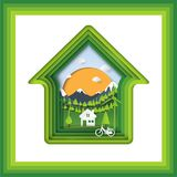 Green eco living house and abstract paper art background Stock Image