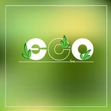 Green eco logo on blurred background. Vector illustration. Stock Photography