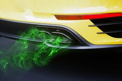 Green eco nature fuel in the car, close up on pollution exhaust Stock Image