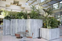 Green eco office building interiors natural light Stock Photos