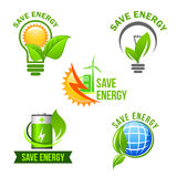 Green eco power and energy saving symbol set. Green power and energy saving symbol set. Eco light bulb with green leaf and sun, solar panel and wind turbine Royalty Free Stock Image