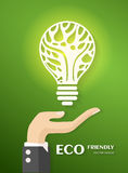 Green ecology bulb on hand Stock Photo