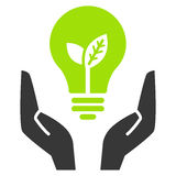 Green ecology bulb in open hands Stock Image