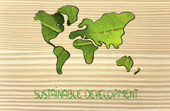 Green economy, world map covered by green leaves. Green economy and sustainable deveolpment, green leaves over continents Stock Photo
