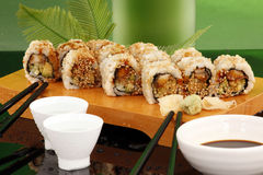 Green Eel roll and sake Royalty Free Stock Image