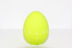Green egg timer in front of white background Royalty Free Stock Photo