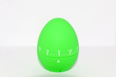 Green egg timer in front of white background Royalty Free Stock Photos
