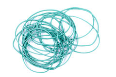 Green elastic bands for money on an  background Royalty Free Stock Photos