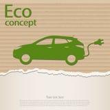 Green electric car on torn cardboard. Stock Image