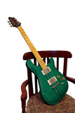 Green Electric Guitar in Chair Royalty Free Stock Photography