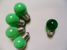 Green electric light bulb on white background Royalty Free Stock Image