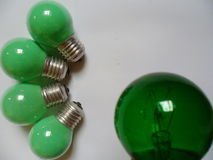 Green electric light bulb on white background Royalty Free Stock Photo
