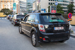Green electric taxi in Brussels, Belgium Royalty Free Stock Photos