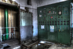 Green electrical case. In abandonned pit Stock Image