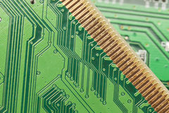 Green Electrical Circuit Board with microchips and transistors Royalty Free Stock Photo