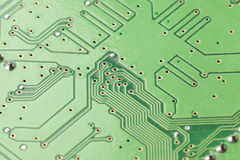 Green Electrical Circuit Board with microchips and transistors Royalty Free Stock Photos