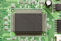 Green Electrical Circuit Board with microchips and transistors Royalty Free Stock Image