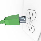 Green Electrical Plug into Wall Outlet. A green heavy duty electrical plug connects to a wall outlet Stock Image