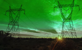 Green Electrical power transmission towers Royalty Free Stock Photography
