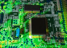 Green electronic board. Illuminated from bottom Stock Image