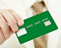 Green electronic plastic card in hand Stock Photography