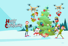 Green Elf Group Decoration Christmas Tree With Drone Wear Virtual Reality Glasses New Year Greeting Card Stock Image