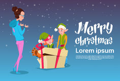 Green Elf Group Give Woman Present Box Greeting Card Happy New Year Merry Christmas Banner. Flat Vector Illustration Royalty Free Stock Photo