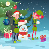 Green Elf Group Making Snowman Near Decorated Pine Tree Merry Christmas Happy New Year Banner Stock Photo