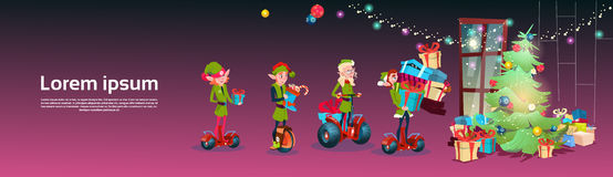 Green Elf Group Ride Scooter Christmas Tree Decorated Interior Holiday Happy New Year Greeting Card Stock Image