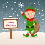 Green Elf with Merry Christmas Sign Stock Photos