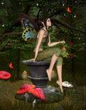 Green elf sits on a pedestal. Midsummer night's dream series - Green elf with lantern Stock Photo