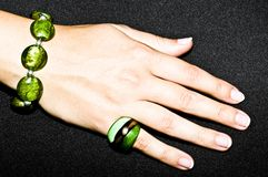 Green emerald bracelet and ring on woman hand Stock Images