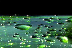 Green emerald bubbles or drops water Stock Image