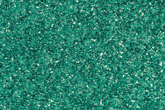 Green emerald glitter makeup background Stock Photos
