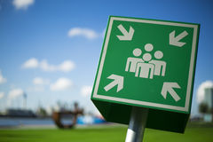 Green emergency assembly point sign Royalty Free Stock Photo
