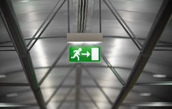 Green emergency exit sign Stock Photo