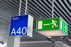 Free Green Emergency Exit Sign, And Blue Gate Sign Royalty Free Stock Images - 19914349