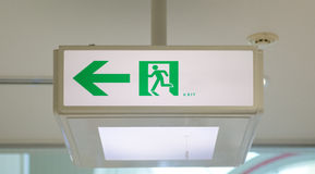 Green emergency exit sign Stock Images