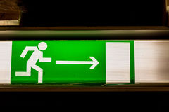 Green emergency exit sign Royalty Free Stock Image