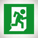 Green Emergency Exit Sign with running human figure. Vector direction sign Stock Photos