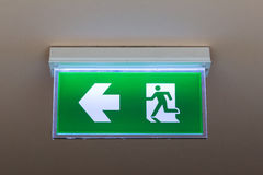 Green emergency exit sign Stock Image