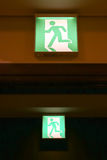 Green emergency exit sign Royalty Free Stock Photography