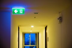 Green emergency exit sign showing the way to escape. Fire exit in the building Royalty Free Stock Photos