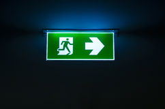 Green emergency exit sign the way to escape. Green emergency exit sign showing the way to escape Royalty Free Stock Photo
