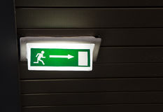 Green emergency exit sign on white Stock Photos