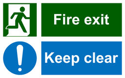 Green emergency exit sign on white. And Keep clear sign. Information mandatory symbol in blue circle isolated on white. Vector illustration Stock Photos