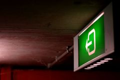 Green emergency light. A green emergency light in an underground car parking Royalty Free Stock Image